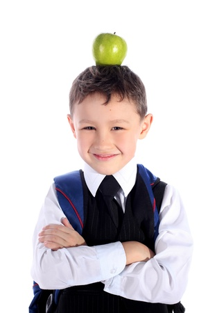 schoolboy with backpack and apple photo