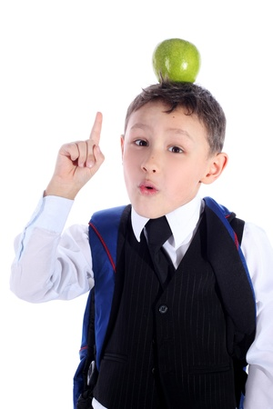 schoolboy with backpack and apple isolated on white photo