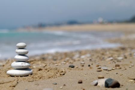 Pebble stack on the seashore photo