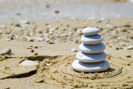 Pebble stack on the seashore photo