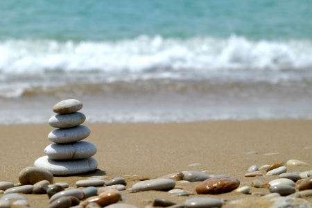 rock bottom: Pebble stack on the seashore
