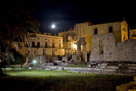 siracuse: classic Italy -old greek temple, moon night in Syracuse, Sicily