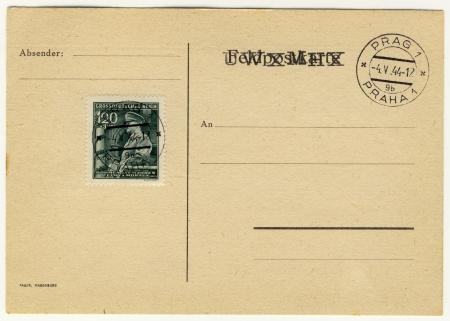 adolf hitler: old envelope with stamp shows portrait of Adolf Hitler  Editorial