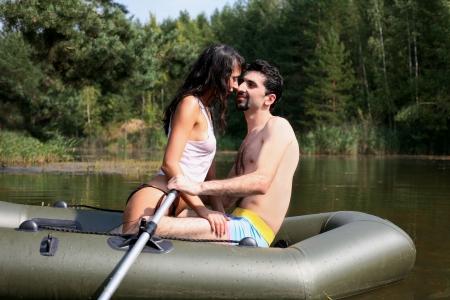 green boat: couple in boat