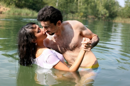 hot sexy girls: couple in water Stock Photo