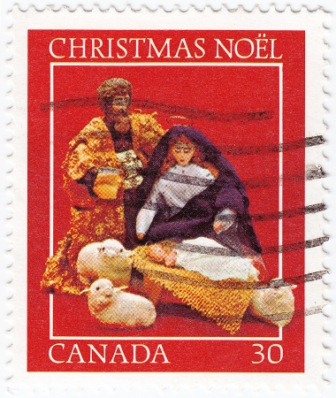 CANADA - CIRCA 1980: stamp shows pic celebrating Christmas Noel with baby Jesus, circa 1980 Stock Photo - 16238252