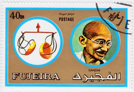 FUJEIRA - CIRCA 1971 : stamp printed in Fujeira, Zodiac Signs of Famous People  shows Mohandas Karamchand Gandhi and the scales of Libra, circa 1971