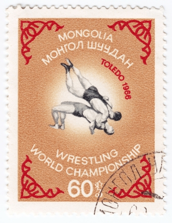 MONGOLIA - CIRCA 1966   post stamp printed in Mongolia shows Wrestling World Championship in Toledo, circa 1966 Stock Photo - 16239846