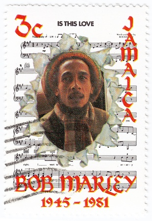 JAMAIKA - CIRCA 1981 : stamp printed in Jamaika with Bob Marley and notes of his song Is This Love, circa 1981