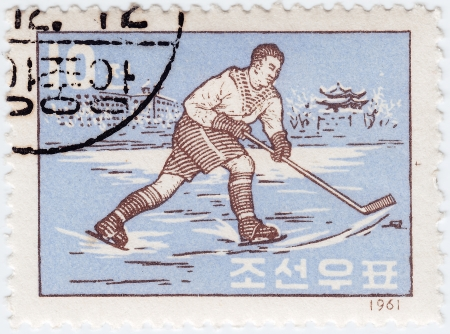 KOREA - CIRCA 1961 : post stamp printed in Korea shows sportsman hockey, circa  1961