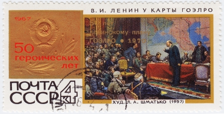 USSR - CIRCA 1967 : stamp printed in USSR honoring 50 years of the USSR in pic by L.Shmatko  Lenin at map GOELRO, circa 1967