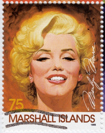 circa: MARSHALL ISLANDS - CIRCA 1995: Stamp printed in Marshall Islands with popular 1960s American actress Marilyn Monroe, circa 1995  Editorial