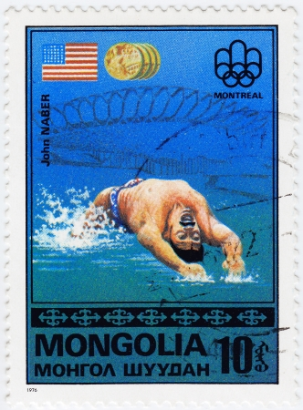 MONGOLIA - CIRCA 1976 : Stamp printed in Mongolia shows American olympic swimmer John Naber in Montreal games, circa 1976