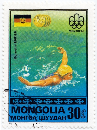 MONGOLIA - CIRCA 1976 : Stamp printed in Mongolia shows German olympic swimmer Kornelia Ender in Montreal games, circa 1976