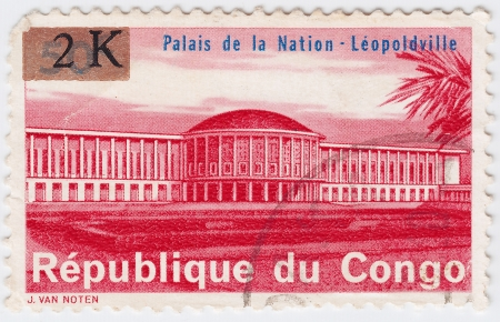 CONGO - CIRCA 1977 : stamp printed in Congo shows Palace of The Nation in Leopoldville city, circa 1977