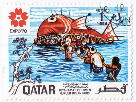 QATAR - CIRCA 1970 : stamp printed in Qatar shows Toyahama fishermen honour Ocean Gods - Whale, circa 1970