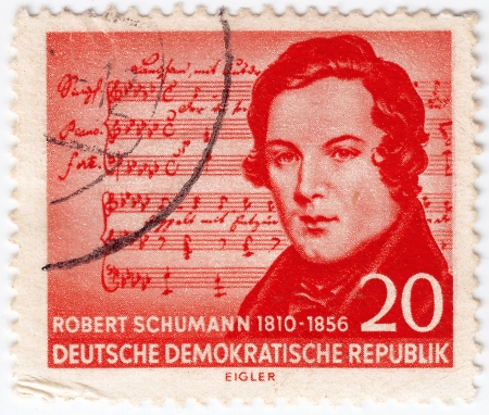 GERMAN DEMOCRATIC REPUBLIC - CIRCA 1956: stamp printed in GDR shows Robert Schumann was a German composer, aesthete and influential music critic, circa 1956 Stock Photo - 16284225