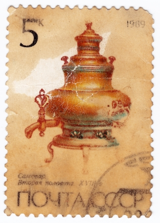 USSR - CIRCA 1989 : post stamp printed in USSR shows old russian tea pot samovar, circa 1989 Stock Photo - 16284172