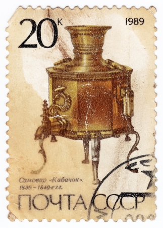 teakettle: USSR - CIRCA 1989 : stamp printed in the USSR shows a brass Kabachok samovar from the 1830s, circa 1989