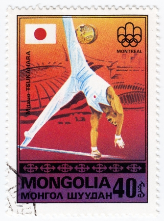 MONGOLIA - CIRCA 1976 : Stamp printed in Mongolia shows Japan olympic athlete Mitsuo Tsukahara in Montreal games, circa 1976 Stock Photo - 16284181