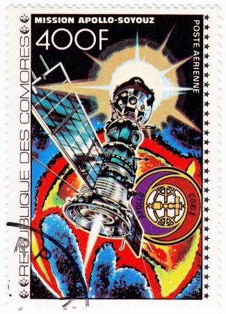 comores: COMORES - CIRCA 1980: stamp printed in Comores shows Apollo and Soyouz  station in space mission, circa 1980
