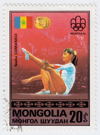MONGOLIA - CIRCA 1976 : Stamp printed in Mongolia shows Olympic athlete Nadia Comaneci in Montreal games, circa 1976 Stock Photo - 16284346