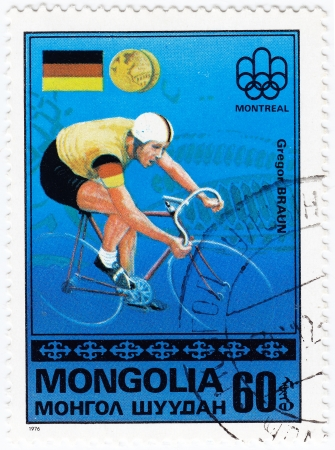 MONGOLIA - CIRCA 1976 : Stamp printed in Mongolia shows German olympic bicyclist Gregor Braun in Montreal games, circa 1976