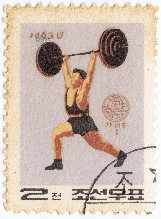 weight lifter: NORTH KOREA - CIRCA 1963 : stamp printed in Democratic Peoples Republic of Korea shows Weight Lifter, circa 1963