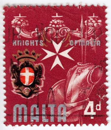 MALTA - CIRCA 1974: stamp printed in Malta shows a armor of Knights of Malta, circa 1974 Stock Photo - 16391468