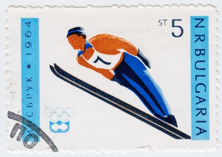 BULGARIA - CIRCA 1964: stamp printed in Bulgaria shows ski jumper in games in Innsbruck, circa 1964 Stock Photo - 16362410