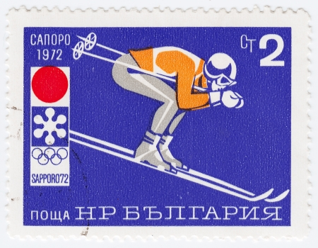BULGARIA - CIRCA 1972: stamp printed in Bulgaria shows ski jumper in winter games in Sapporo, Japan, circa 1972 Stock Photo - 16362470