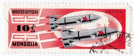 MONGOLIA - CIRCA 1962 : stamp printed in Mongolia shows the soviet exploration with Vostok space stations, circa 1962  Stock Photo - 16393233