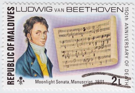 MALDIVES - CIRCA 1977 : stamp printed in Maldives shows Ludwig van Beethoven and Moonlight Sonata manuscript 1801 year, circa 1977 Stock Photo - 16376463