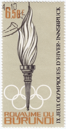 BURUNDI - CIRCA 1964 : Stamp printed in Burundi shows the torch in IX  Olympic Winter games in Innsbruck, circa 1964