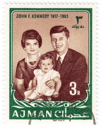 AJMAN - CIRCA 1965   stamp printed in Ajman show John F Kennedy  R , her wife  Jacqueline and daughter Caroline, circa 1965