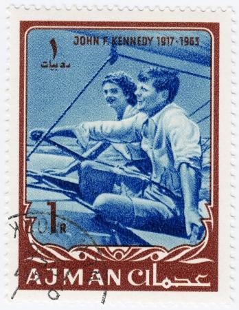 AJMAN - CIRCA 1965   stamp printed in Ajman show John F Kennedy  R  with wife Jacqueline, circa 1965 Editorial