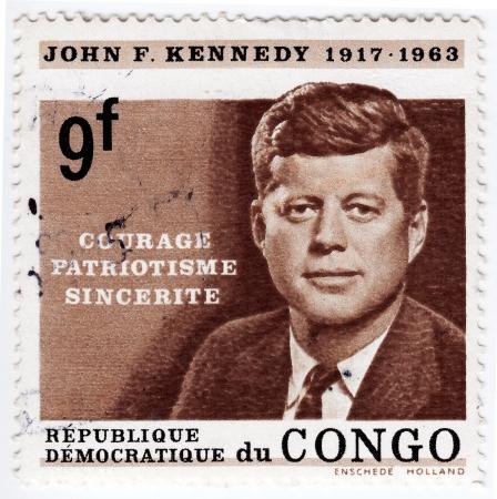 john fitzgerald kennedy: CONGO - CIRCA 1963   Stamp printed in Congo shows 35th president of USA - John Fitzgerald Kennedy, circa 1963