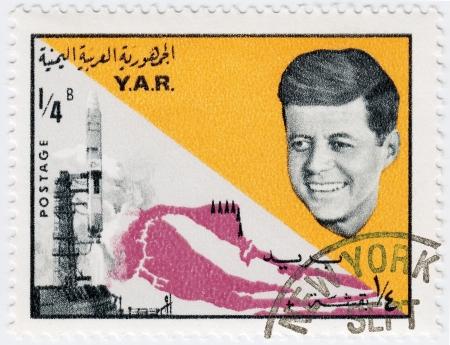 jfk: YAR - CIRCA 1970 : Stamp printed in YAR shows John F Kennedy background usa flag and spaceshuttle , circa 1970  Editorial