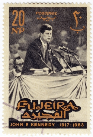 john fitzgerald kennedy: FUJEIRA - CIRCA 1963 : Stamp printed in Fugeira shows 35th president of USA - John Fitzgerald Kennedy, circa 1963