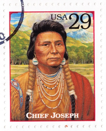 indian postal stamp: USA - CIRCA 1994 : Stamp printed in the USA shows Chief Joseph - chief of the Wal-lam-wat-kain (Wallowa) band of Nez Perce, humanitarian and peacemaker in old West, circa 1994