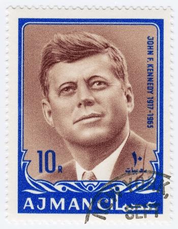 jfk: AJMAN - CIRCA 1970 : Stamp printed in Ajman shows John F Kennedy, circa 1970