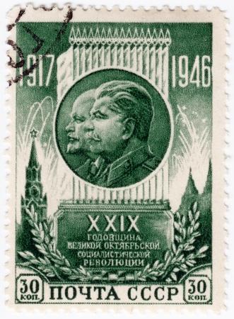 RUSSIA - CIRCA 1946 : 29 anniversary of the Russian Revolutions with portrait her leaders - Joseph Stalin(R) and Vladimir Lenin, circa 1946 Stock Photo - 16425157