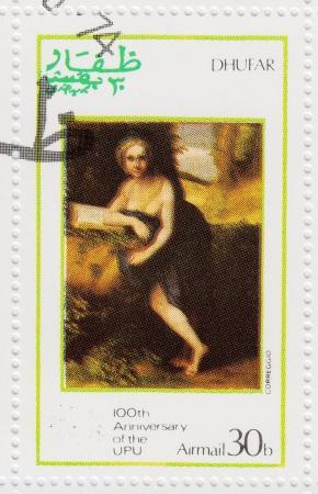 DHUFAR - CIRCA 1974: stamp printed in Dhufar shows pic to painter Correggio of 100th Anniversary OF UPU ( Universal Postal Union ), circa 1974 Stock Photo - 16425141