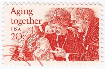 65 70 years: USA - CIRCA 1950   stamp printed in USA with happy family in Aging Together, circa 1950 Editorial
