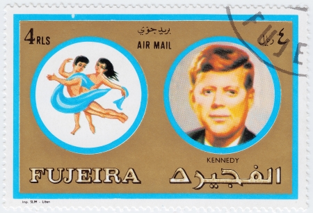 FUJEIRA - CIRCA 1971 : stamp printed in Fujeira, Zodiac Signs of Famous People  shows image of John F Kennedy and Gemini, circa 1971  Stock Photo - 16507478