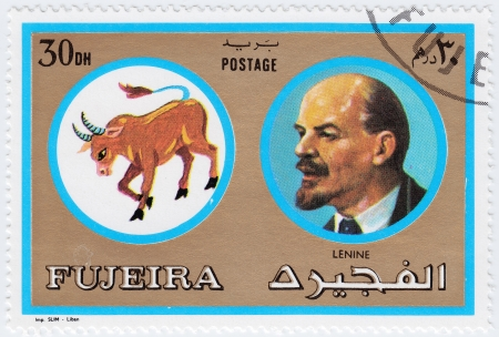 FUJEIRA - CIRCA 1971 : stamp printed in Fujeira, Zodiac Signs of Famous People  shows Lenin was a Russian revolutionary,, circa 1971  Stock Photo - 16507492