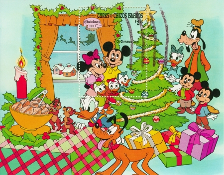 TURKS , CACOS ISLANDS - CIRCA 1983 : Christmas stamp printed in Turks , Cacos show Mickey with famoly at Christmas tree, circa 1983