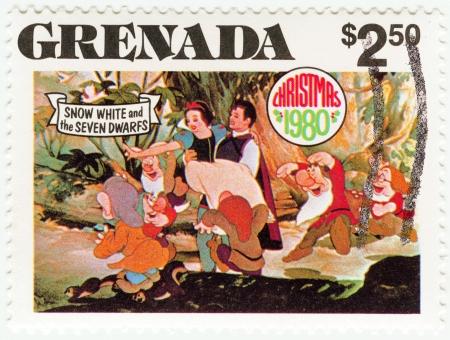 GRENADA - CIRCA 1980 : stamp printed in Grenada shows Snow White and The Seven Dwarfs cartoon at Christmas, circa 1980 Editorial