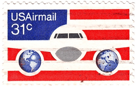 united states postal service: USA - CIRCA 1985  stamp printed in USA shows aeroplane at background US flag,  circa 1985
