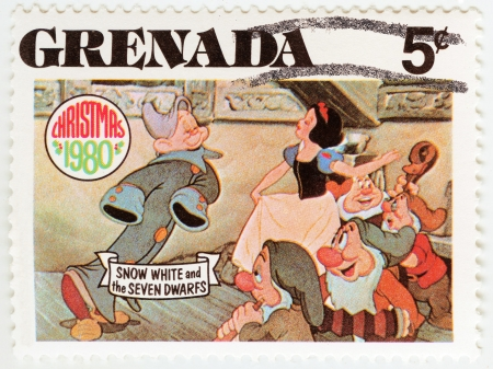 seven dwarfs: GRENADA - CIRCA 1980   stamp printed in Grenada shows Snow White and The Seven Dwarfs cartoon at Christmas, circa 1980